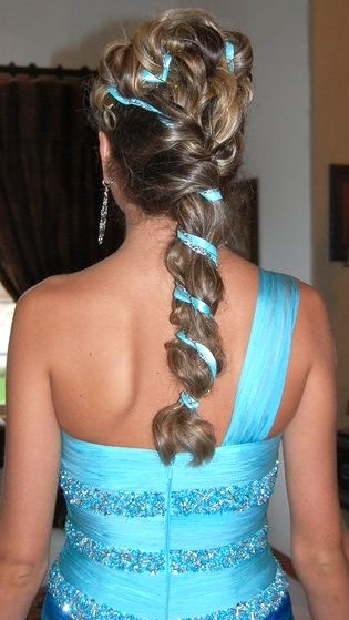 Partial updo with ribbon weaved through hair