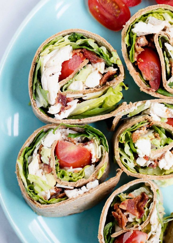 Chicken Caesar Wraps …a quick, delicious lunch or appetizer that is light on calories! These Chicken Caesar Wraps feature crispy bacon, juicy tomatoes, avocado, lettuce and Caesar dressing.
