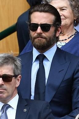 Bradley Cooper wearing Persol 1042/58 Polarized Sunglasses and Tom Ford O'Connor Base Sharkskin Suit in Bright Navy