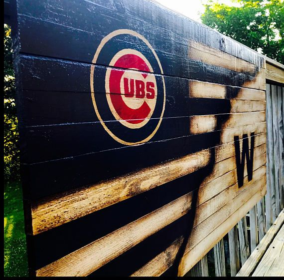 This is a custom made Chicago Cubs flag. This Wood flag incorporates the best of both worlds for the Chicago Cubs enthusiast, the modern Cubs logo in the upper left and the Cubs W in the lower left. This Chicago cubs Win wooden flag is made of 13 individual pieces of wood. The Chicago Cubs Win flag is then painted and age distressed to give it a rustic appearance thats timeless. Its dimensions are 36 x 20. A larger Chicago Cubs Win wood flag sign is offered in the size of 48 x 26. The…
