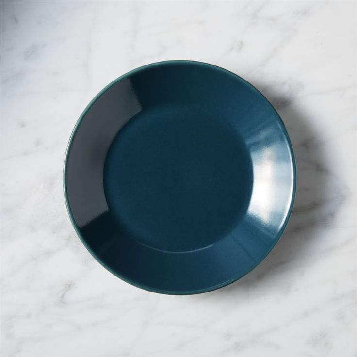 Shop amuse blue-green appetizer plate.   Vivid rounds of glaze-dipped stoneware serve up starters in a fun handheld size.  CB2