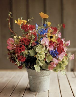 wrong colors, but just as an example I have a bunch of these tin buckets that we could use for a low cost option for the centerpiece vases
