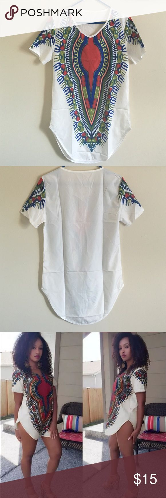 Dashiki shirt dress It's a size medium but fits like a xsmall or small. Brand new, never worn Tops Tunics