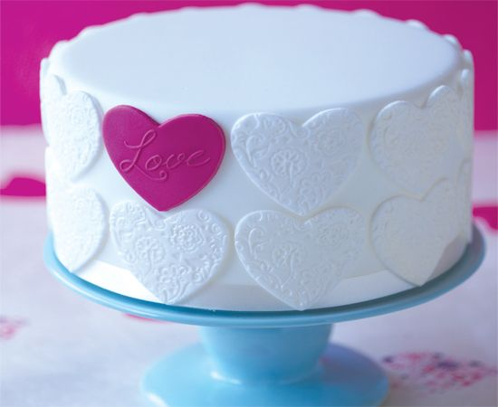 heart cake with one pink heart. Simple but sweet.