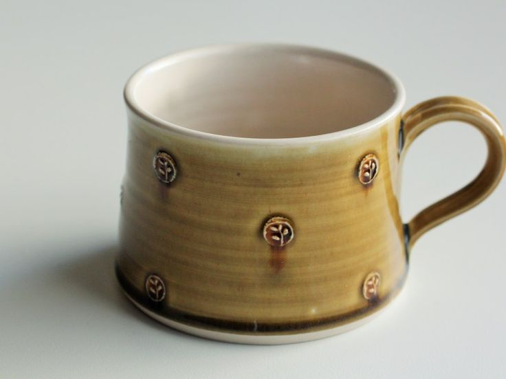 Thrown cup, stoneware clay.