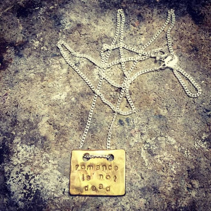 ROMANCE IS NOT DEAD - silver/brass necklace via DDsthlm. Click on the image to see more!