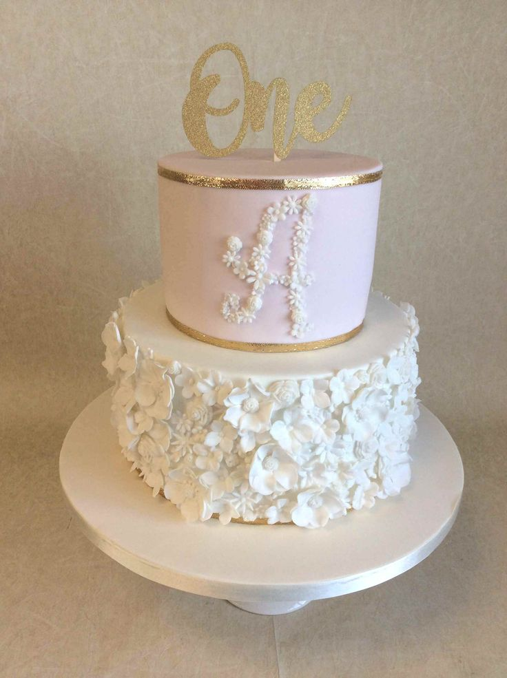 2 tier pale pink and gold floral design 1st birthday cake