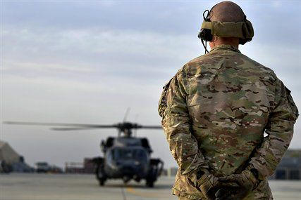 U.S. Air Force Airman 1st Class Josh Lombardo prepares to marshal a HH-60G Pave Hawk helicopter on Bagram Airfield, Afghanistan, Nov. 22, 20...