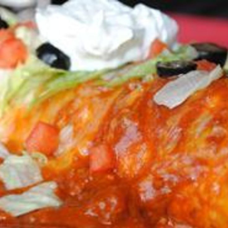 """Very easy, yet very good wet burritos. I got this recipe from a friend, and everyone I serve them to asks for the recipe. Serve with guacamole, sour cream and salsa."""