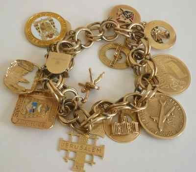 Vintage Estate Charm Bracelet with 11 14K Yellow Gold Charms