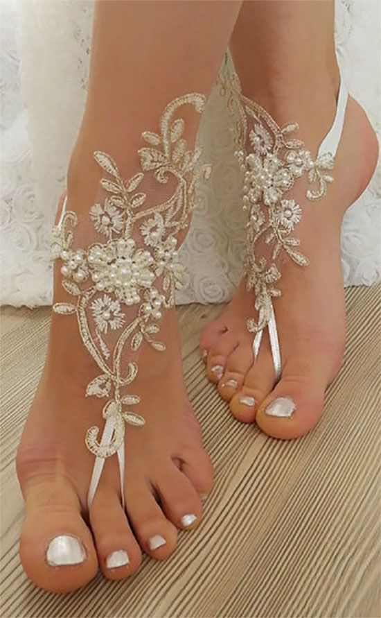 Barefoot beach wedding shoes. Beaded, with wedding lace and pearls. https://myonlineweddinghelp.com/barefoot #BarefootSandals #BeachWedding #DestinationWedding