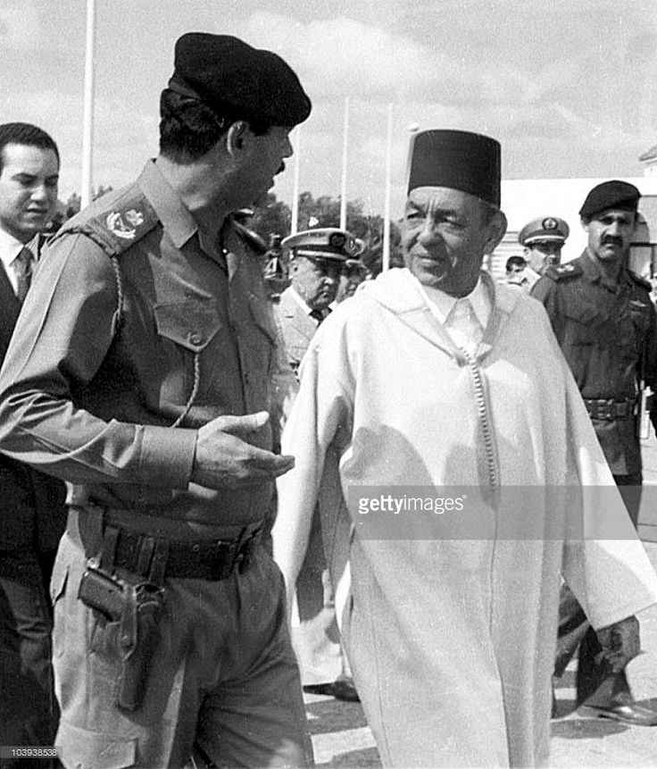 Picture dated November 1989 showing King Hassan II of Morocco (R) greeting Iraqi President Saddam Hussein upon his arrival in Rabat for an Arab summit in November 1989. King Hassan II died suddenly 23 July 1999 at the age of 70 after a reign of 38 years. BLACK
