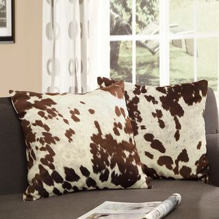 Cow hide print throw pillows add neutral accents to a living room or bedroom.