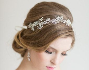 A pretty floral hair vine for your wedding day hair. Handcrafted by twisting wire to individually add every single flower, leaf, crystal, rhinestone and faux pearl. The pretty flower blossoms are 100% silk and available in Ivory, Champagne or Blush Pink colors. It is flexible and can shape to any hair style and can also be worn as a head band by adding ribbon. It has a small comb at each end for securing it to your hair. (shown in Gold/Blush Pink)  COLOR: Available in silver or Gold wire…