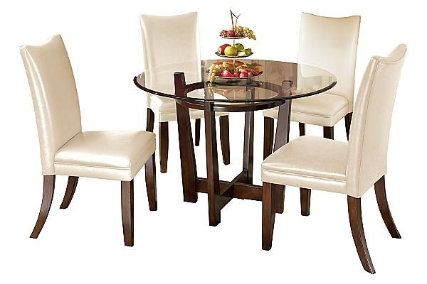 The Charrell Round Dining Room Table From Ashley Furniture