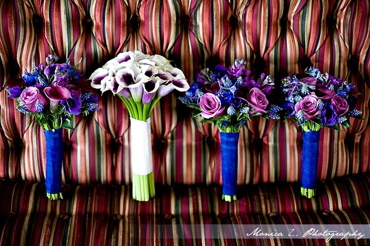 Love the bridesmaid flowers, wrapped with navy or purple velvet ribbon.