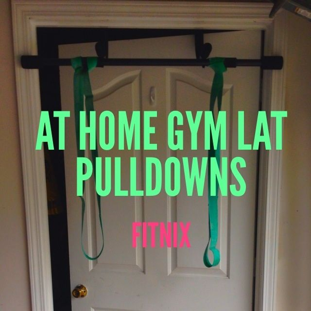 Seated lat pulls from home gym. Over the door pull up bar and heavy resistance bands. #training #lats #muscle #athomegym #sahm #fitmom #baby #getfit