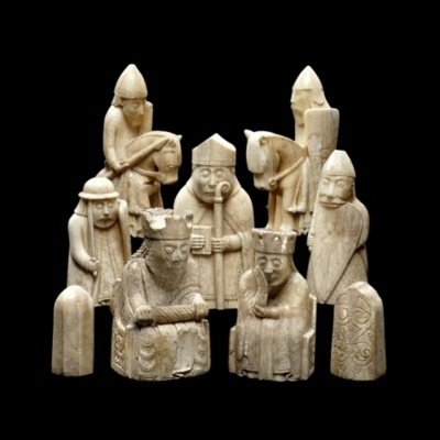 These chess pieces, called the Lewis Chessmen, were found in Scotland at some point before 1831 and were probably made in Scandinavia between 1150 and 1200. They're made out of walrus ivory and whales' teeth and are on display at The British Museum.