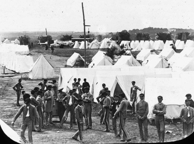 The uniforms are very old style, braided coatees and French style kepis. Looks more like American Civil War uniforms, similar to the uniforms worn by the cadets of the famous Richmond military school of the Confederacy.