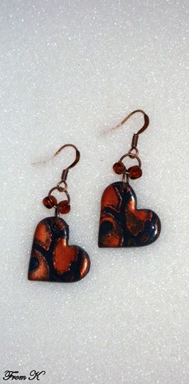 Heart dangle Earrings. These lightweight earrings are made from black polymer clay, and then carefully polished with wax-based silver medium over a stencil. The combination of colors colors will add charm to any outfit. Supplemented with Czech seed beads. About 3,5 cm long with ear piece. 12.00 Ron