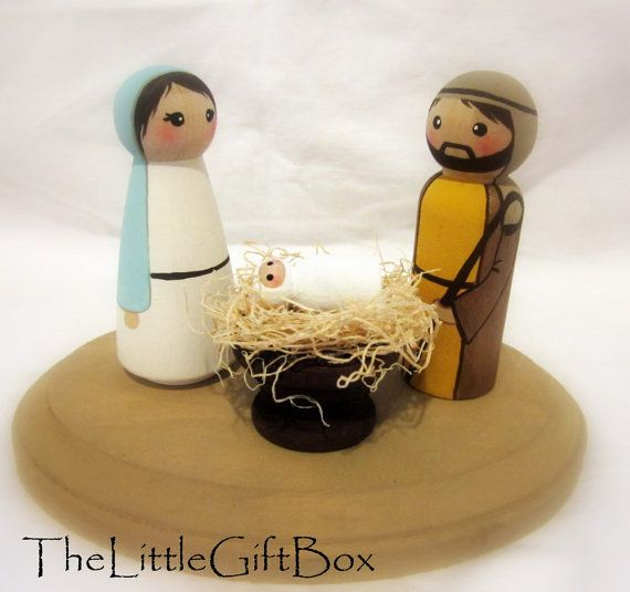 I could totally make this wooden Nativity. Needs more glitter...