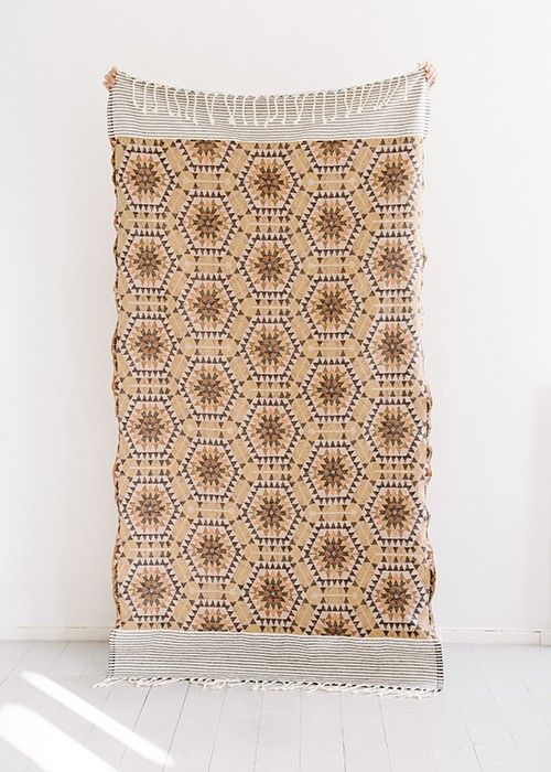 How great wouldn't this beautiful peachy sand-coloured blanket look thrown a bit carelessly on your favourite armchair