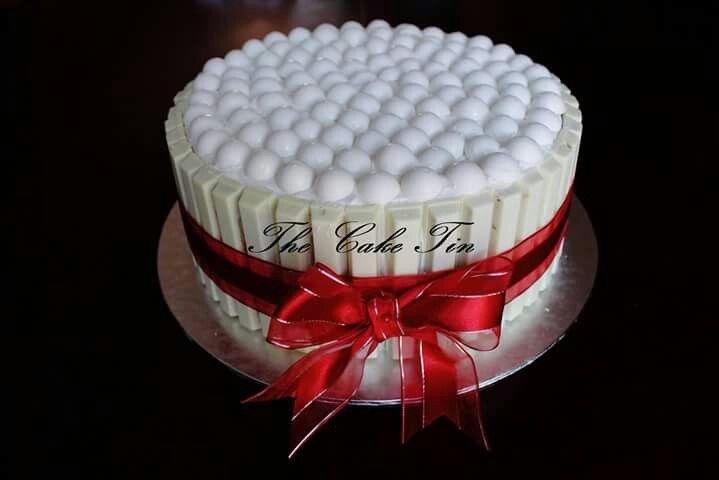Vaniella cake and white choc surrounding the cake and white geldorf choc on top