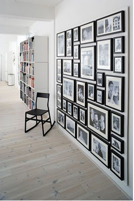 I want a wall like this in my house of pictures of my family....