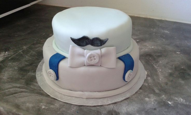 Little man baby shower cake. White chocolate mud cake covered in fondant icing