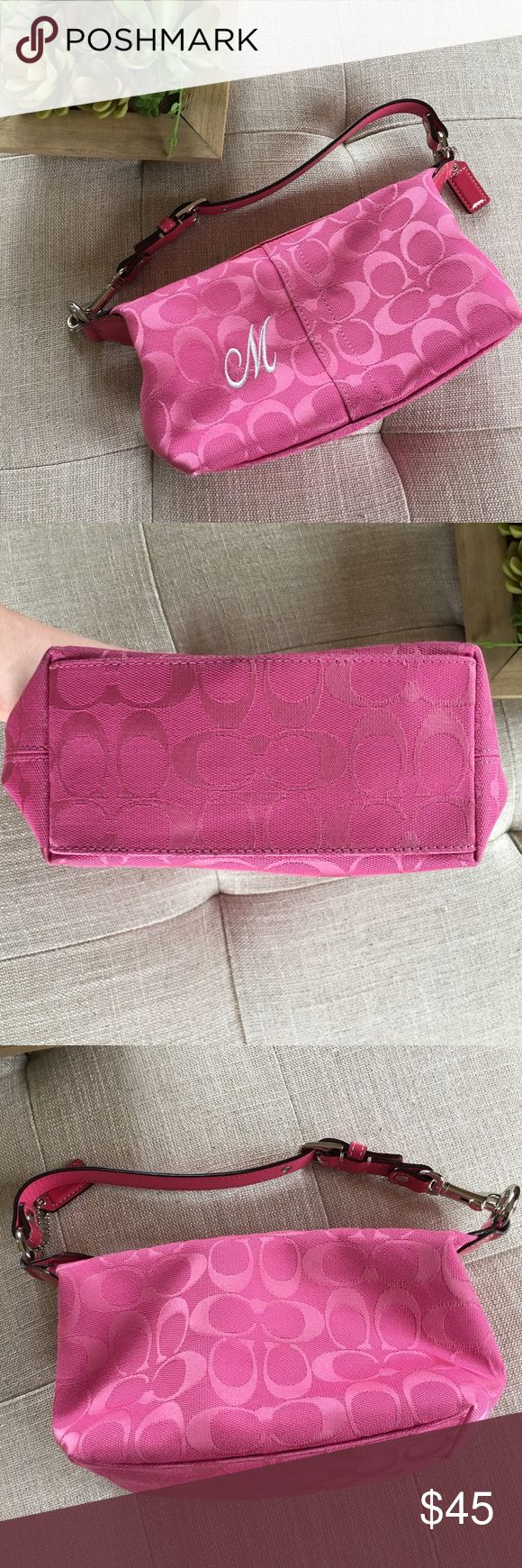 """Coach Purse Pink coach purse with the letter """"M"""" on the front. Gently used and in great condition. The strap has three lengths but it doesn't get much longer than in the picture Coach Bags Shoulder Bags"""