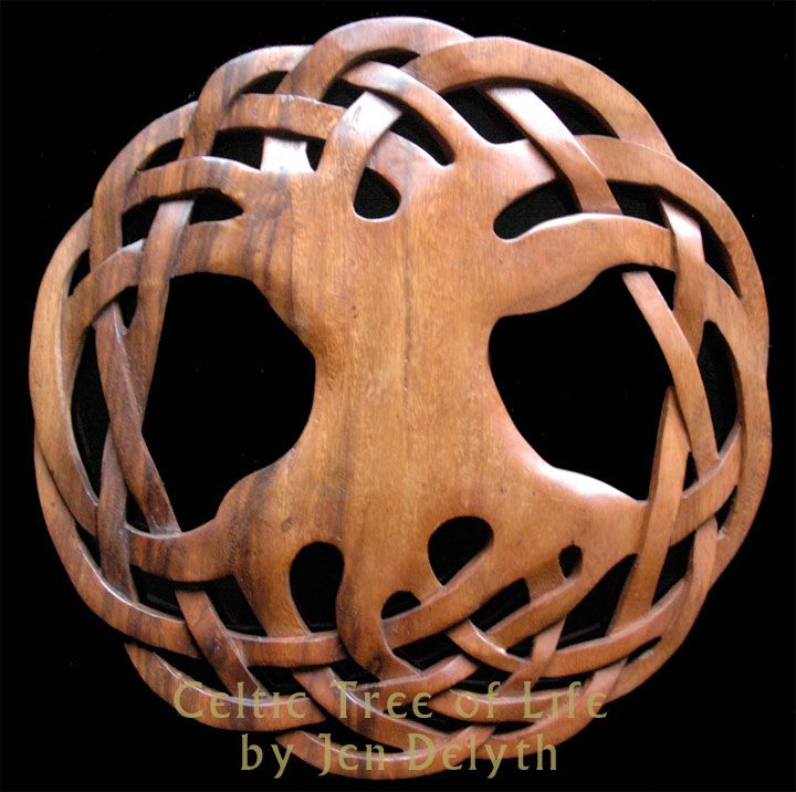 Celtic Tree of Life - carved wood wall art and Tree of Life design by Welsh artist Jen Delyth. From the look of the picture, the knot-work of the intertwining branches was sculpted to look 3-dimensional. And the wood grain is gorgeous as well...