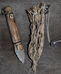 A replica of the knife and sheath found with Otzi the Iceman on the Italian/Austrian border, now in Bolzano   museum