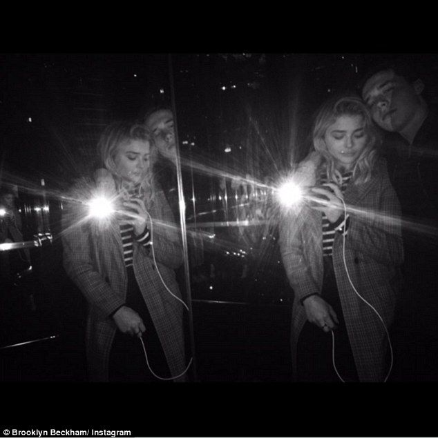 Cosy couple: Brooklyn Beckham has teased fans with a coupled up snap with his rumoured girlfriend Chloe Moretz which he posted on his Instagram page on Sunday