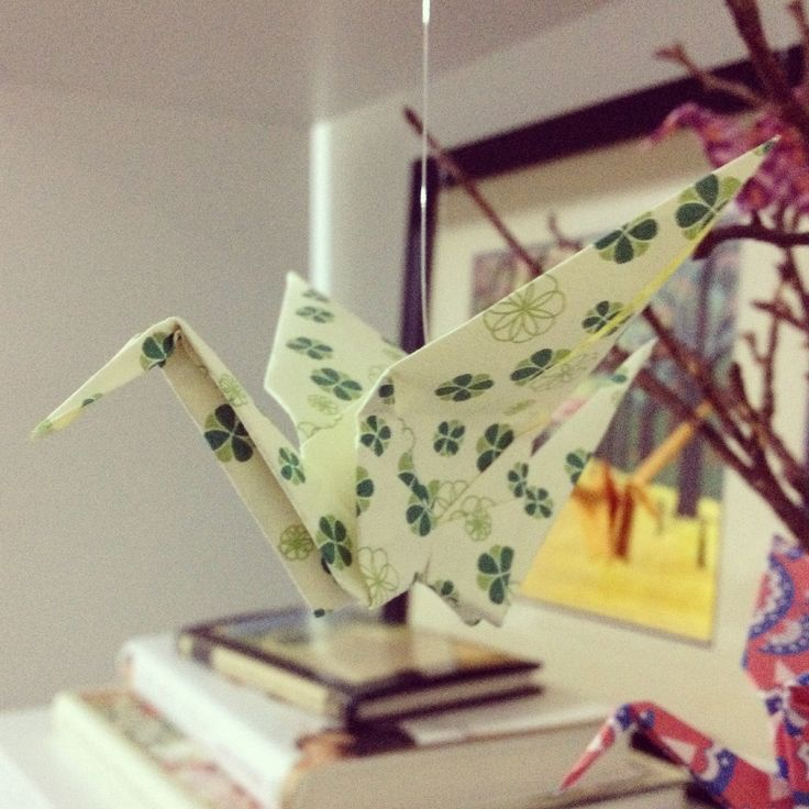 Paper crane made from 'Seraphina' pattern available on Etsy shop Tell Them Stories