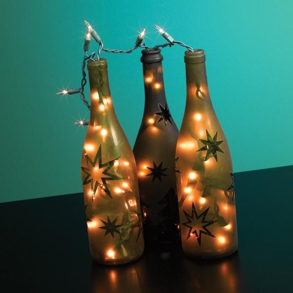 Festive Wine Bottle Lights Project   Transform Empty Wine Bottles Into Festive  Home Décor With A Coat Of Spray Paint, Mini Lights And Holiday Stencils.
