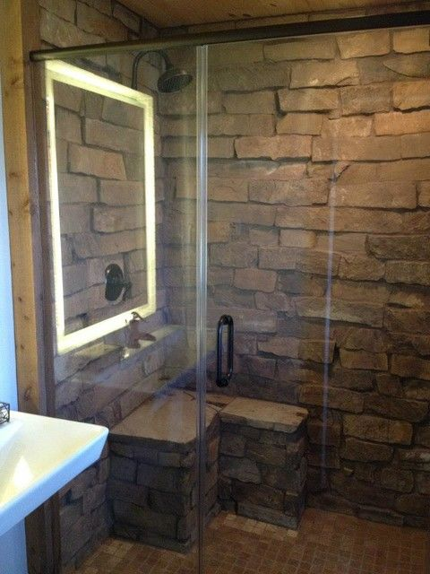 Heavy stone clad walls, more suited to an outdoor shower
