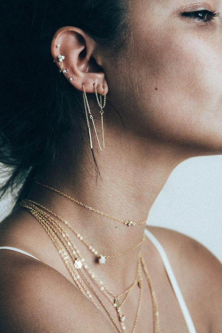 The Ayumi Threaders are delicately feminine earrings comprised of a subtle threader chain with a fine thin drop. styling tip: Wear them solo, or double them up! product details: Handmade in high quali