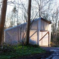 British practice Invisible Studio has completed a model-making shed beside its self-built studio in the Bath woodland, using a combination of timber grown and milled on site, and corrugated fibreglass.