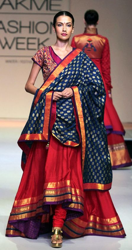 A model displays a high and low patch work frock with churidaar pajama and Benarsi stuffed contrast dupatta at an LFW event. Source: TrendyOutlook