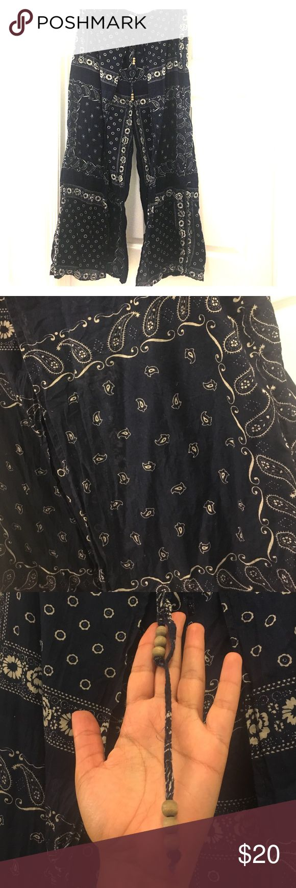 """Ralph Lauren Denim & Supply Palazzo Pant Bandana themed palazzo pant by Denim & Supply.  Slowly pant with navy and white Banda print all over.  Elastic and tie waist closure that includes wooded bead accents.  Inseam 27"""".  Measures 39"""" from waist to hem. Denim & Supply Ralph Lauren Pants Wide Leg"""