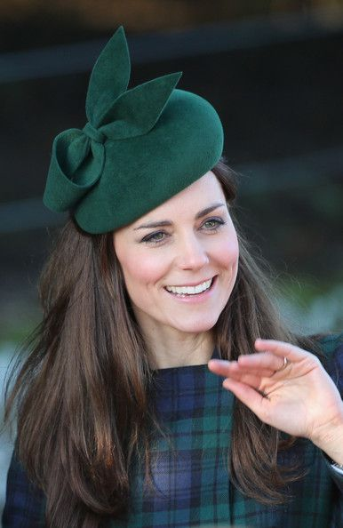 Catherine, Duchess of Cambridge arrive for the Christmas Day service at Sandringham on December 25, 2013 in King's Lynn, England.
