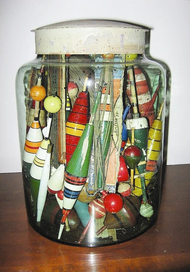 antique bobbers....Budget-friendly displays can be made of anything — from inexpensive fishing lures to old farm tools. (Photos by Linda Sarubin)