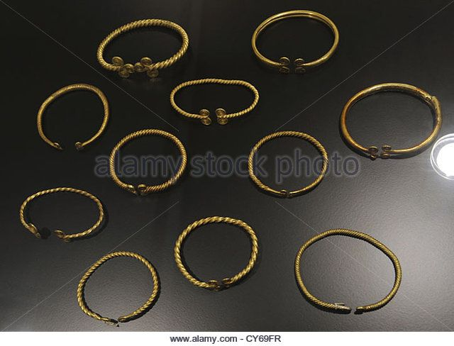 Smooth and spiral bracelets in gold. Early Bronze Age, 1700-1100 BC. National Museum of Denmark. Copenhagen. Denmark. - Stock Image