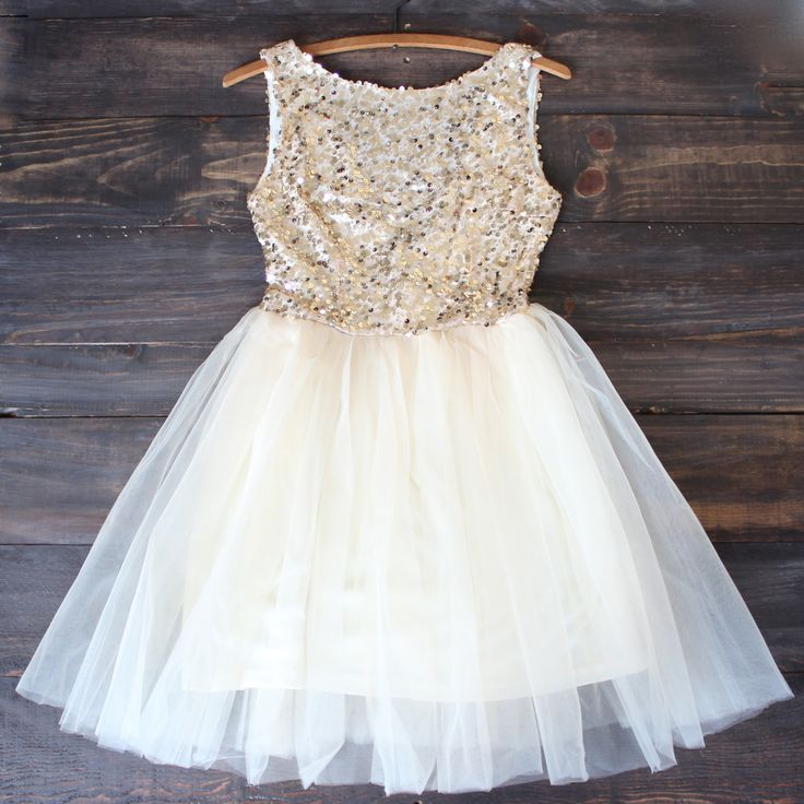 Beautiful gold sequins adorn this ballerina style tulle bottom yellow-gold dress. A darling dress for any special occasion. Perfect for prom, homecoming, birthday party, and other special events. S M