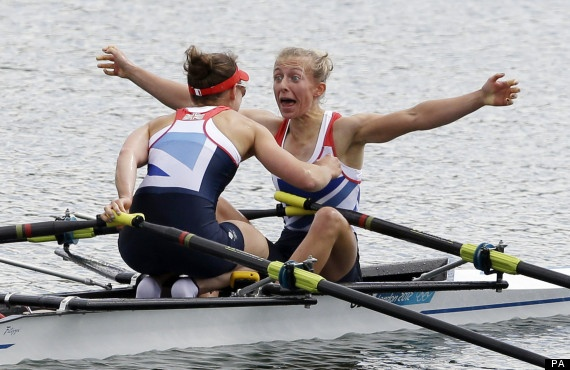 Katherine Copeland, left, and Sophie Hosking celebrate after winning the gold medal for the lightweight women's rowing