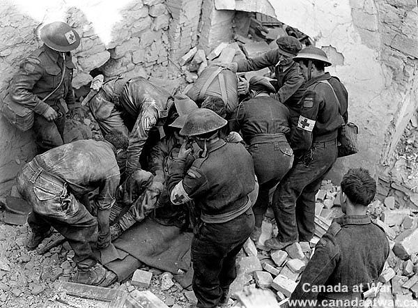 Ortona - Members of the Edmonton Regiment digging out a comrade who was buried alive in the wreckage of a building demolished by the enemy.