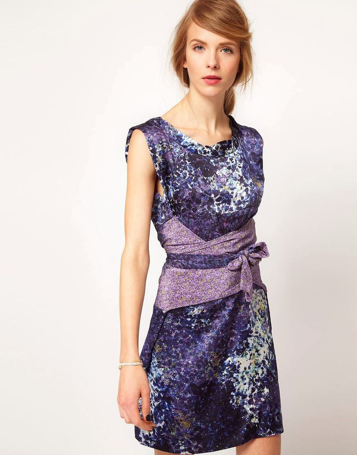 Buy it now. Edun Sleeveless Dress In Mix Print With Self Belt - Blue. Silk dress by Edun. Crafted in premium pure silk printed with a delicate paint fleck design. Featuring a round neckline with twisted bound edge, sleeveless styling, a wraparound belt in contrast floral silk print with tie fastening, and a fluid cut through the skirt. Designed with a short length. Edun was born in 2005 out of a love of beautiful clothes and the desire to create change by Ali Hewson and Bono. Designed by…