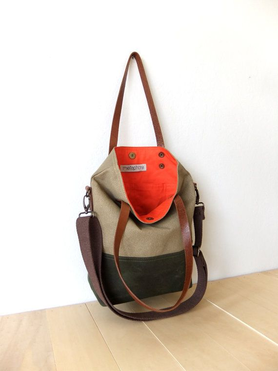 This foldover bag has a waxed canvas base in olive green. It has waterproof body in beige. It can be used as a tote and messenger bag. It has two interior pocket. Interior lining is from orange cotton. It has leather handles in brown and an adjustable detachable cotton strap in dark brown. It is suitable for both men and women.  Now you can find this bag in black : https://www.etsy.com/listing/218523454/waterproof-foldover-bag-convertible-tote?ref=shop_home_activ...