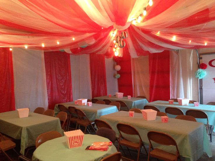 Circus Tent In Garage Made From Tulle And Plastic Table
