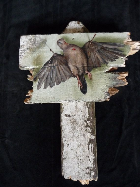 Dead pigeon - oil paint on reclaimed wood by Saskiart. This painting is a statement about world peace. Detail: two rusty nails have been hammered in the wings...